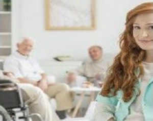 caregiver in front of patients