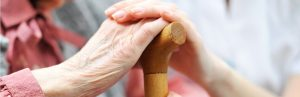 image of hands on a cane