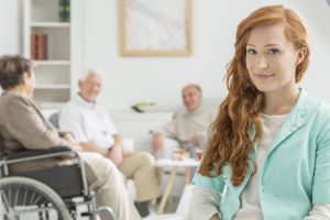 young and red-haired nurse at retirement home