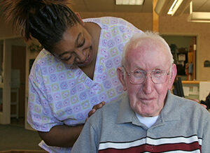 caregiver with smiling man