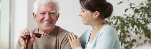 Senior man with daughter or caregiver