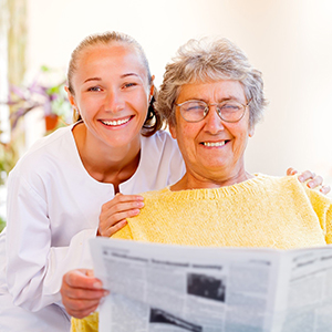 image of a caregiver smiling with a woman