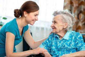 caregiver smiling with a senior lady