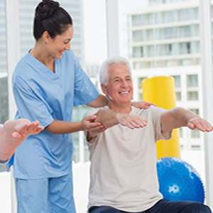 seniors exercising with caretaker