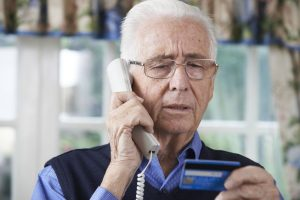man paying with credit card over phone